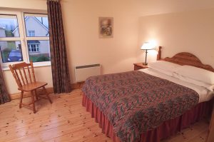Bedroom at Dingle Marina Cottages